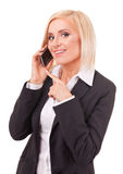 Happy female executive speaking on a cellphone Royalty Free Stock Images