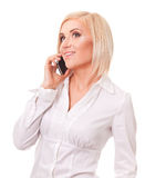 Happy female executive speaking on a cellphone Royalty Free Stock Image