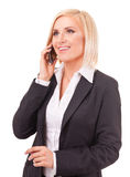 Happy female executive speaking on a cellphone Stock Photography