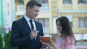 Happy female fan asking for autograph from handsome famous man suit, celebrity. Stock footage stock video