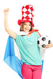 Happy female fan with hat and dutch flag holding a football Stock Image