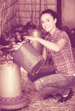 Happy female farmer in farm house Stock Photo
