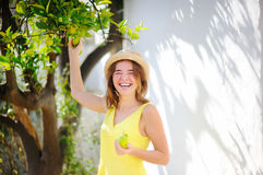 Happy female farmer working in fruit orchard Royalty Free Stock Photo