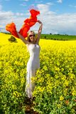 Happy female in field of golden flowers, zest for life stock photos