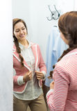 Happy female at fitting-room Stock Photography