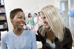 Happy Female Friends At A Baby Shower Stock Image