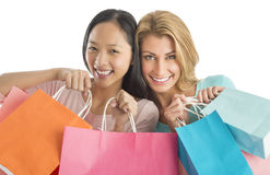 Happy Female Friends Carrying Shopping Bags Royalty Free Stock Photos