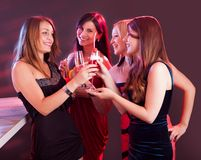 Happy female friends celebrating Royalty Free Stock Photos