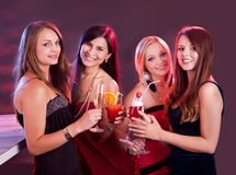 Happy female friends celebrating royalty free stock image