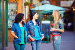 Happy female friends on evening street Royalty Free Stock Photo