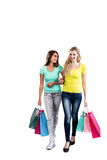 Happy female friends holding shopping bags Stock Photos