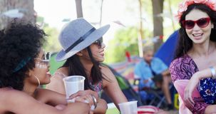 Female friends interacting with each other at music festival 4k. Happy female friends interacting with each other at music festival 4k stock video