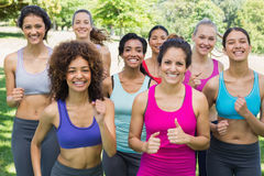 Happy female friends jogging in park Royalty Free Stock Photography