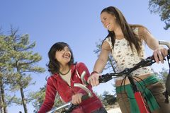 Happy Female Friends With Mountain Bikes Royalty Free Stock Photo