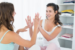 Happy female friends playing clapping game Royalty Free Stock Images