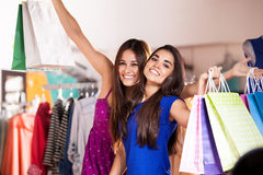 Happy female friends shopping Royalty Free Stock Photography
