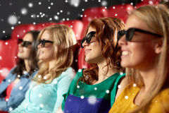 Happy female friends watching movie in 3d theater Stock Photos