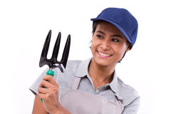Happy female gardener service staff, hand holding cultivator gar Royalty Free Stock Photos