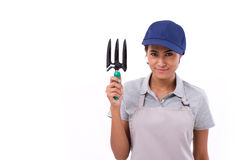 Happy female gardener service staff, hand holding cultivator Stock Photo