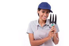 Happy female gardener service staff. Hand holding cultivator gardening tool Royalty Free Stock Photo