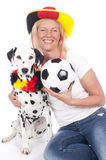 Happy female german fan with dog Royalty Free Stock Photos