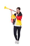 Happy Female German Supporter Blowing Vuvuzela Stock Photo