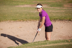 Happy female golfer in a trap Stock Photography