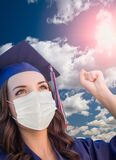 Graduate in Cap and Gown Wearing Medical Face Mask