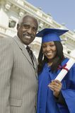 Happy Female Graduate With Father Royalty Free Stock Photo