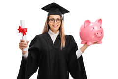 Happy female graduate student holding diploma and piggybank Stock Images
