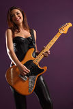 Happy female guitarist Stock Photography