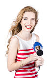 Happy female hairdresser holding hairdryer Royalty Free Stock Photography