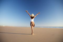 Happy female with hat walking at beach Royalty Free Stock Photography