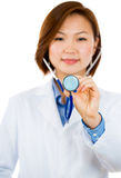 Happy female healthcare professional or doctor or nurse holding out stethoscope Royalty Free Stock Photo