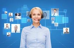 Happy female helpline operator with headphones Royalty Free Stock Photos