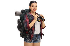 Happy female hiker holding a binoculars Stock Photography