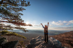 Happy female hikerat the summit of an Appalachian mountain Royalty Free Stock Images