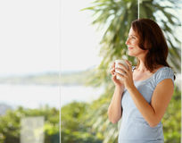 Happy female holding a coffee cup Stock Image