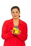 Happy female holding small house Stock Image