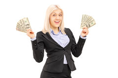 A happy female holding US dollars Royalty Free Stock Image