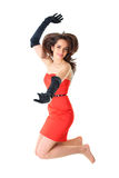 Happy female jump up, red dress, isolated on white Royalty Free Stock Photo