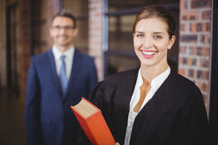 Happy female lawyer with businessman royalty free stock photography