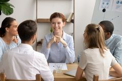 Happy female leader and diverse business team having friendly conversation royalty free stock images