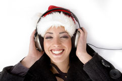 Happy female listening music and wearing christmas Royalty Free Stock Image