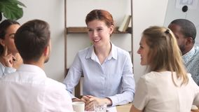 Happy female manager handshake thank male worker finish group meeting. Happy female boss manager thank male worker finish group meeting, smiling friendly stock video