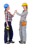Happy female manual workers Stock Photos