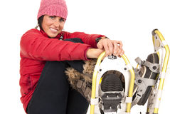 Happy female model sitting down in snow shoes Stock Photo