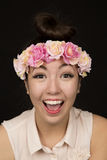 Happy female model wearing a floral crown portrait Royalty Free Stock Photos