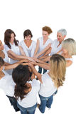 Happy female models joining hands in a circle Royalty Free Stock Images