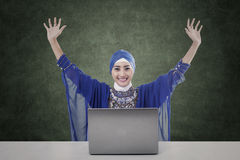 Happy female muslim with laptop and blank board Stock Photos